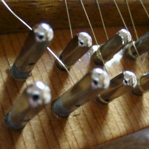 A sharp bend is put into the wire to prevent it from slipping out of the tuning pin hole
