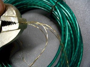 Green vinyl-coated clothesline was stripped and used as the strings for our bowed psaltery