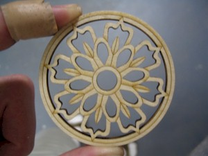 A laser-cut rose for decorating the soundhole