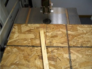 A special jig is used to cut a 10 miter on the side pieces