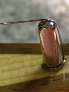 A notch is filed in the top of the hitch pin to allow a smooth curve for the string's path
