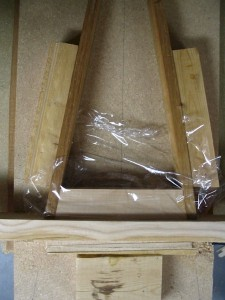 A simple jig is used to ensure that the pinblock stays put during glue-up