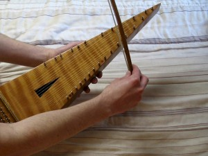 The bowed psaltery is played along the sides of the instrument
