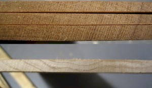 On top are three pieces of quartersawn redwood, while the maple seen below is flat-sawn