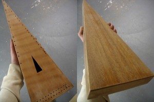 Front and back views of the psaltery after pore-filling and sanding