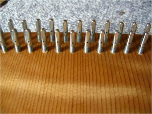 An overall look at the tuning pins before the strings are wound on them