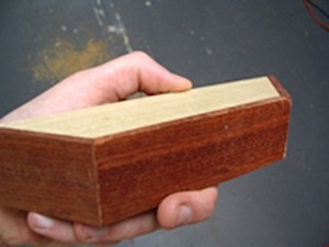 The same wood from the sides was used to cover the back of this pinblock