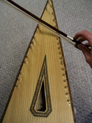 The bowed psaltery is played along the sides